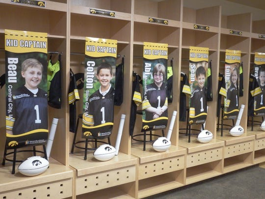Posters for the Children's Hospital and UI Hawkeye Football Kid Captains hang in the Hawkeye's home locker room at Kinnick Stadium on Aug. 15.