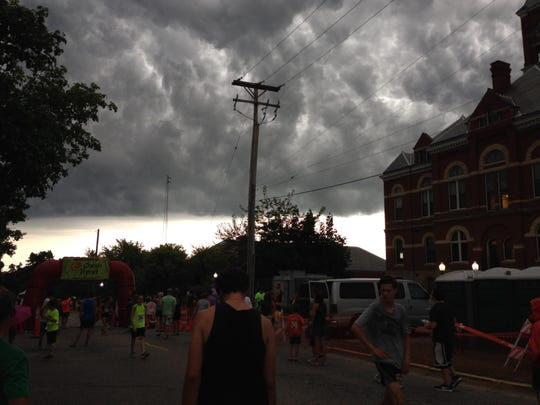 Thunderclouds loom over the finish line at Friday's Melon Run. A few minutes later, heavy rain pelted the area as the race went on.