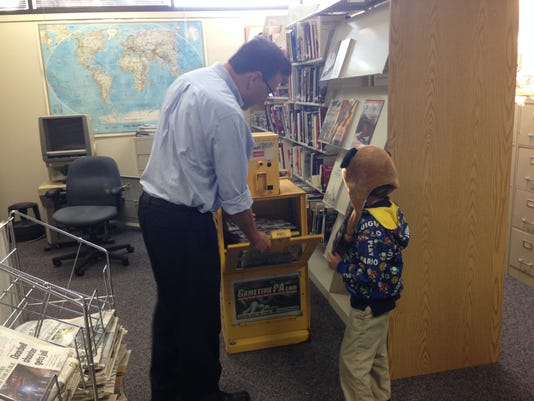 YDR Managing Editor Randy Parker shows off a newspaper box to 6-year-old Elijah Wonder, of York.