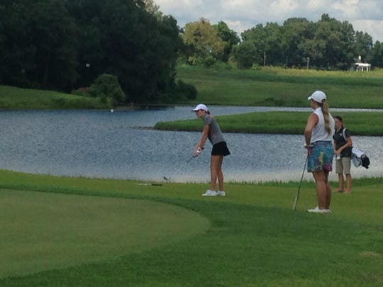 Greenfield's Anna Grace Huggins chips onto the green