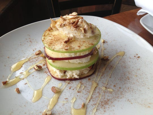 At Harvest Local Seasonal Cuisine in Farmingdale, dessert offerings include the Harvest apple napoleon, made with thinly sliced Red Delicious and Granny Smith apples stacked with marscapone cream, cinnamon and pecans and topped with local wildflower honey