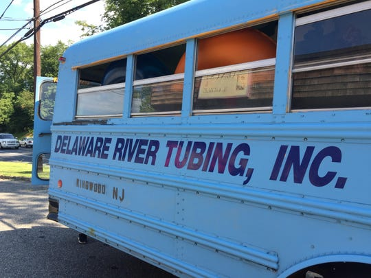 Tubers piled onto the Delaware River Tubing bus for a ride to the public launch in Milford, New Jersey on Sunday.