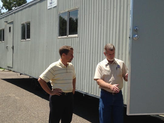 A mobile home becomes the temporary pro shop at Bent Tree. David Zeip (left) is the general manager at the golf course, and Tom Winbush (right) is Jackson's director of housing and building codes.