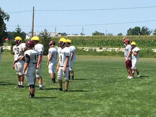 Genoa's offense waits for the next play during a preseason practice.