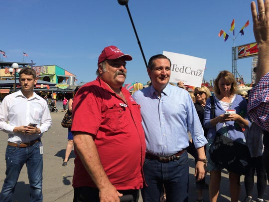 U.S. Sen. Ted Cruz, right, poses for a picture at the Iowa State Fair on Friday, Aug. 21, 2015, in Des Moines, Iowa.