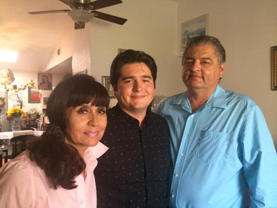 "Lincoln Castellanos, who will appear on the premiere episode of ""Fear the Walking Dead"" on Sunday, poses with his parents Lupita and Ricardo Castellanos."