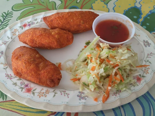 Puffy pastelitos at El Salvador restaurant are stuffed with beef and vegetables. The dough is tinted with achiote, a Caribbean and Latin American red spice.