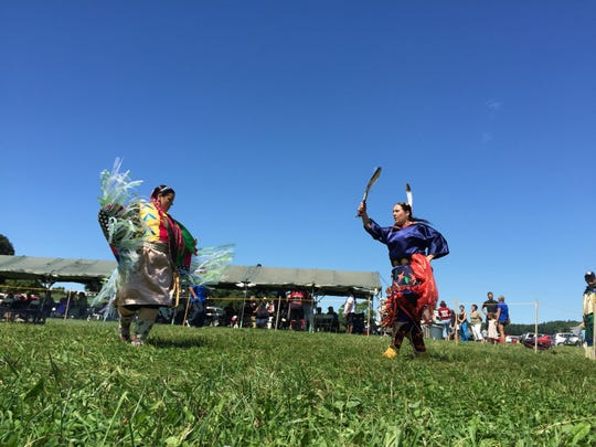Liz Charlebois, left, of Warner, New Hampshire, and Jill Cresey-Gross of Westford, Massachusetts, dance during a Wabanaki Confederacy celebration Saturday at Shelburne Farms.