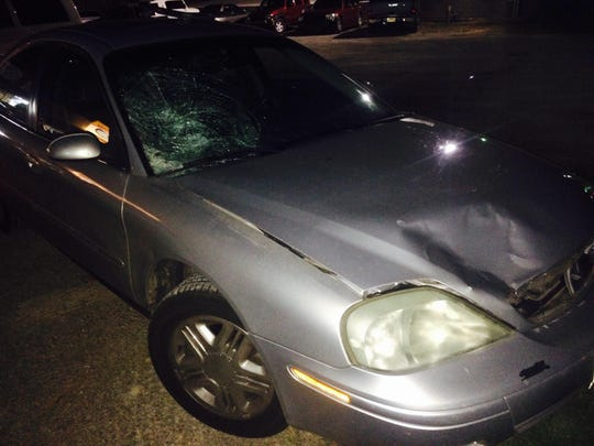 Pictured is the gray sedan after it struck Micheal McKenzie late Friday night on U.S. Highway 62 East in front of the Royal 66.