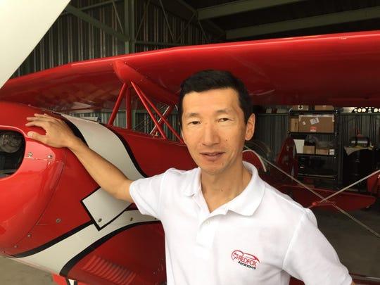 Yuichi Takagi pauses for a photo while maintaining his Pitts aerobatic biplane in his King City hangar. Takagi will perform at the Salinas Airshow on Sept. 26-27.