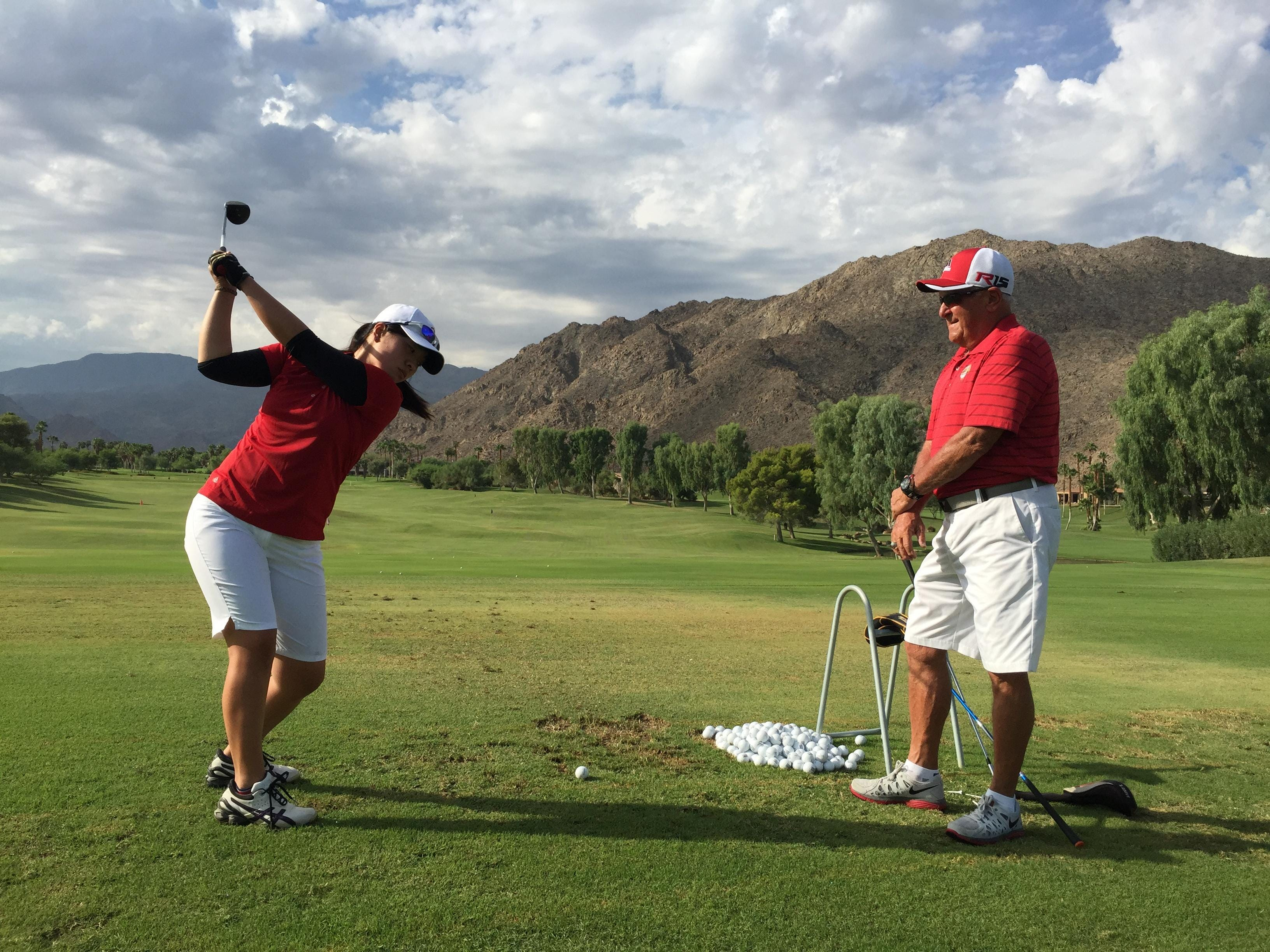 College of the Desert Roadrunners women's golf coach Gary Sabella watches his team's top player Fumika Matsumoto practicing on the driving range at Ironwood Country Club in Palm Desert. The Roadrunners at the defending state community college champions.
