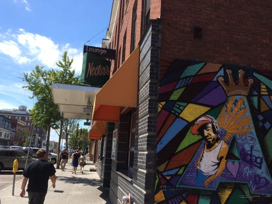 A mural painted on an exterior wall at Nectar's honors DJ A-Dog, aka Andy Williams.