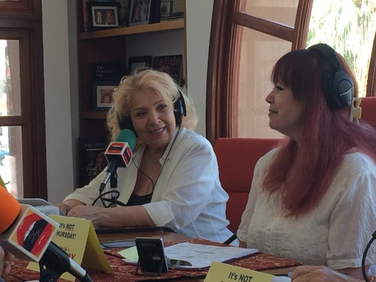 Astrologer Dana Haynes on left sits with Joey English during a taping of the Joey English radio show. Haynes is on once a month to discuss horoscopes.