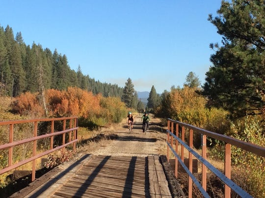 Anne Wallace Allen and her husband, Eric Allen, cross one of many bicycle bridges on the Weiser River Trail in central Idaho.