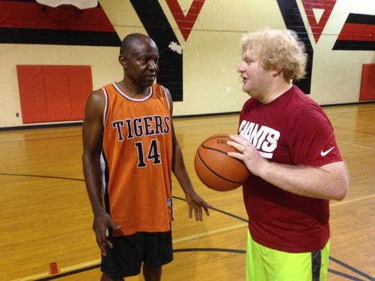 George Woods (left) and Bryant Newell shoot baskets at the YMCA on Monday.