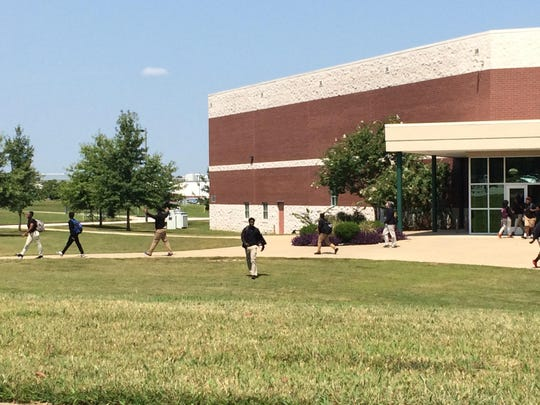 Students walk between classes at Liberty Technology Magnet High School on Monday.
