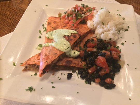 This images shows only HALF the portion of the quesadilla lunch special at Rapscallion. Beans, rice and pico de gallo accompany the quesadilla.