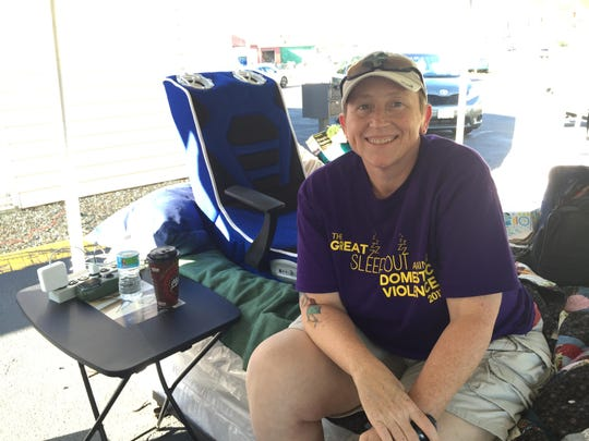 "Edith Gilliland represents Richland County Children Services as the ""Great Sleep Out Against Domestic Violence"" continues Saturday."
