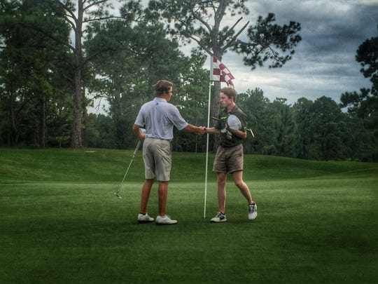 Chiles junior Connor Futrell shakes hands with Lincoln's Jeremiah Holiday after a round at Seminole Golf Course.