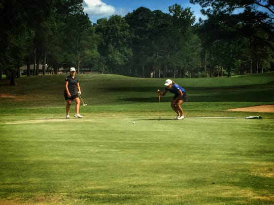 John Paul II golfer Grace Murray gets her read for a putt during a round at Killearn Country Club last week.