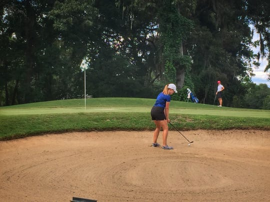 John Paul II golfer Teresa Conroy attempts a sand save during a round last week at Killearn Country Club.