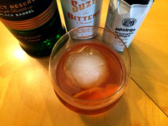Jessica Taylor, bartender at JW Marriott, made a Classic Old Fashioned using ingredients from her home bar.