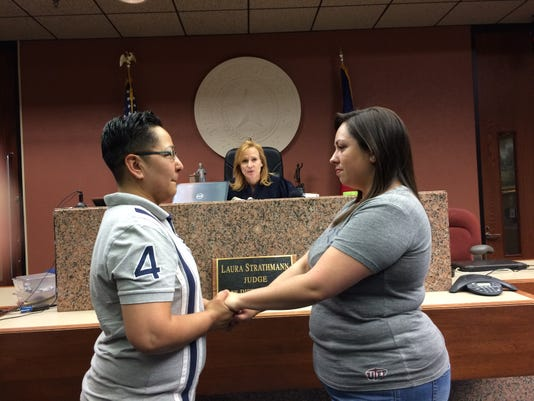Aixa Adame, left, and Lacey Darcy, right, are married at the El Paso County Courthouse in Downtown El Paso.