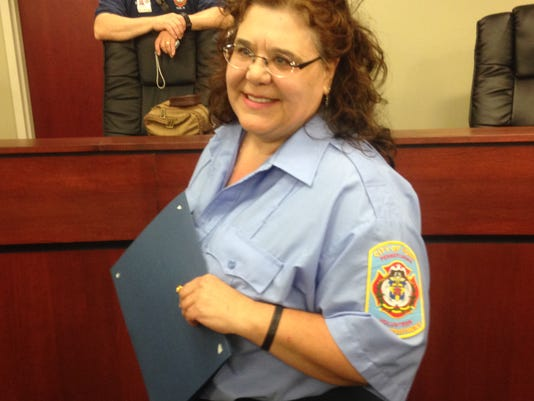 Lisa Welty, 54, of York, holding her certificate for York's Department of Fire/Rescue Services 2014 volunteer of the year. Welty started volunteering at the city's Eagle Fire Company in 1990 so she could spend more time with her husband.