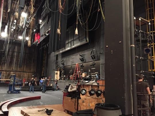 A large structural post, right, obstructed access to Music Hall's stage and required stagehands to disassemble large pieces of the set, as seen here during Cincinnati Opera season in July.