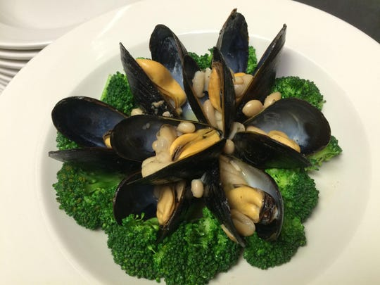 Mussels with beans, broccoli and silver roasted garlic sauce served at Gourmet Café, Parsippany.