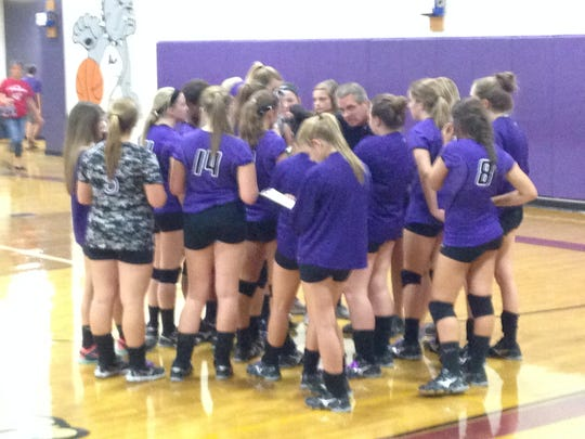 Milan's volleyball players listen to coach Todd Sheppard during Thursday's game vs. Crockett County.