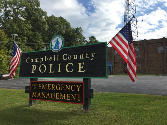 Flags adorn the entrance to Campbell County Police Department will purchase 25 new body cameras for officers to wear and use by January.