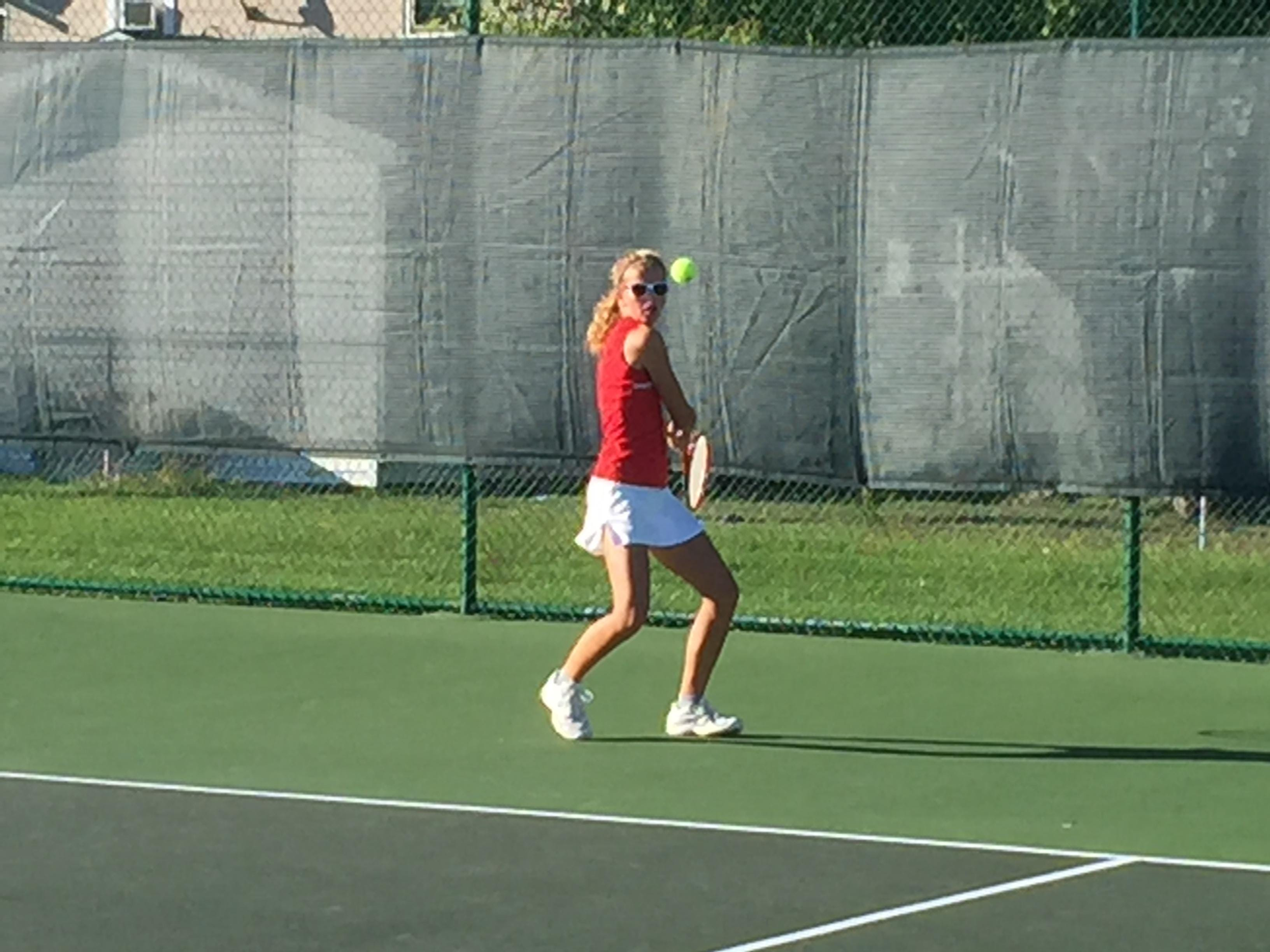 Port Clinton's Emma Eickert tracks a backhand Tuesday against visiting Clyde.