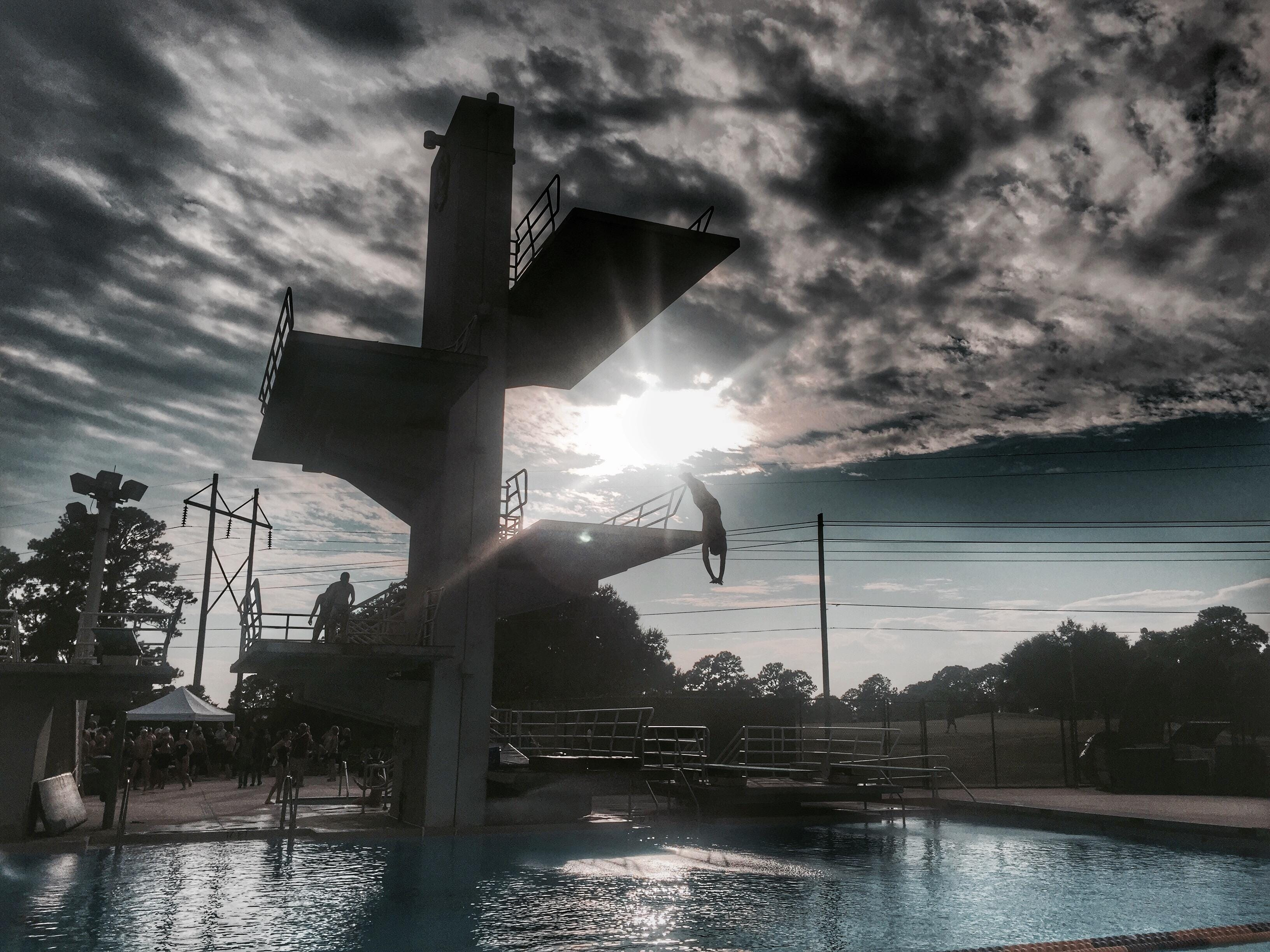 As the sun sets on FSU's Morcom Aquatic Center, Chiles junior Chase Lane falls from the 10-meter platform into the water headfirst.