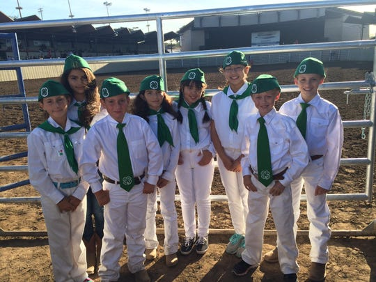 Beginning 4-H members prepare to display the American flag at the Flying U rodeo.
