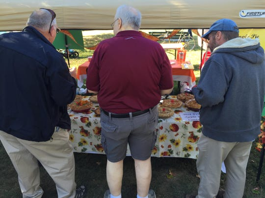 Pie judges, from left, Don Keeler, Addison County sheriff; Mike Donoghue, reporter, Burlington Free Press; and Trent Campbell, photographer, Addison Independent.