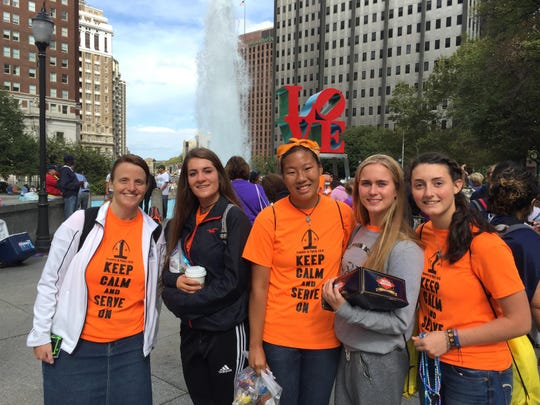 From left, Jill Swallow, director of formation at Everest Collegiate High School and Academy in Clarkston; and 11th-graders Brooke Beauchamp, 16; Clare Nalepa, 16; Emily Milosch, 16; and Sarah Stafford, 17; pause in front of the LOVE sculpture in Center City Philadelphia, on Sept. 27, 2015.