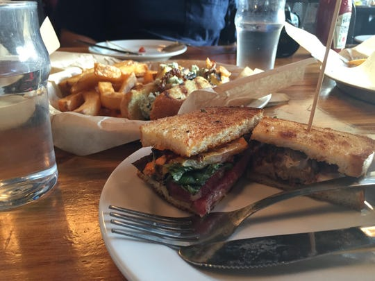 Two of Madison Social's new sandwiches, the AC Slagle and the meatball grilled cheese.
