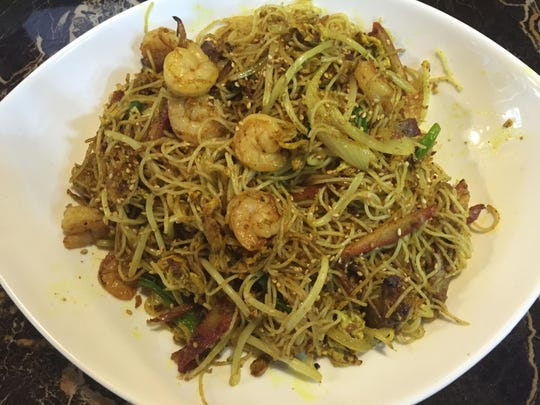 Steaming Singapore noodles are loaded with shrimp and barbecued pork. They're served here with extra curry.