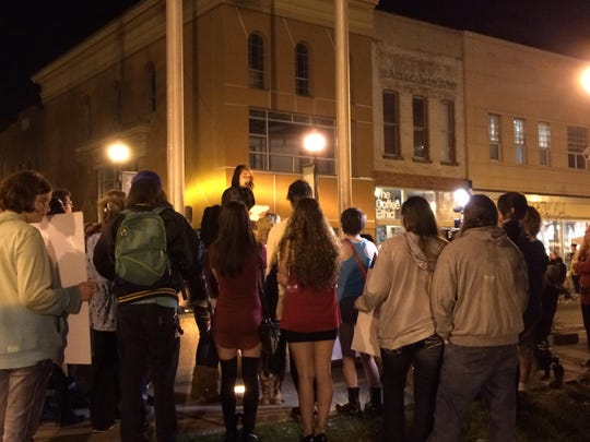 """SlutWalk 2015"" activists gathered on the square Friday night following their four-block walk."