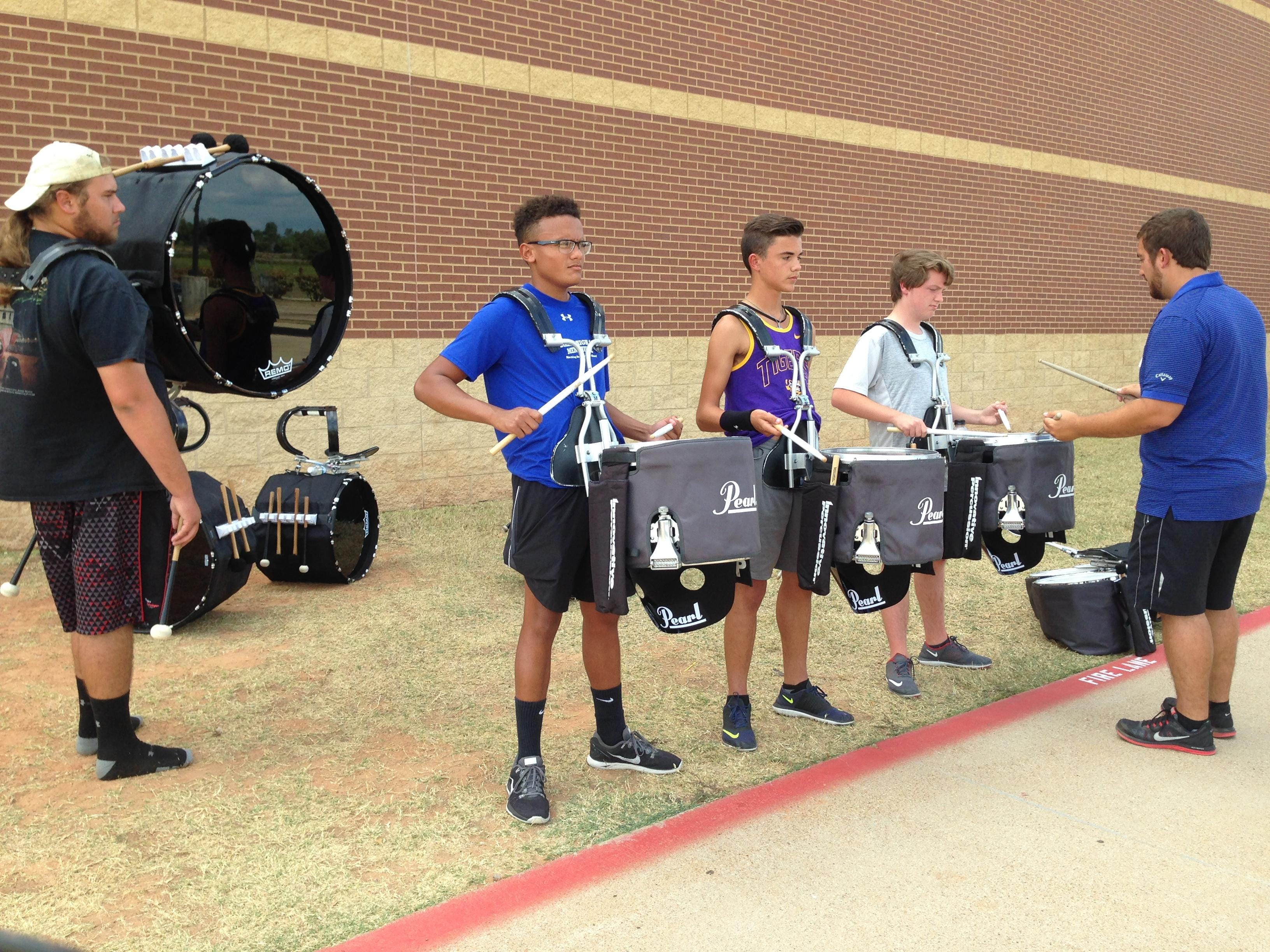Parkway drumline rehearses for next performance.