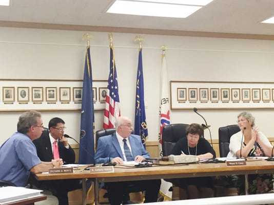 Lebanon City Council Vice-chairman Wayne Carey presides over a discussion about limiting the number of cats someone can own during Monday's meeting with fellow council members (from left) Richard Wertz, Tony Matula, city administrator Debbie Gates, and Pat Royer.