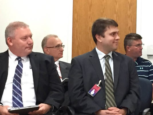 Shawn Canady  (left) and Dustin Nikles listen as they are introduced at Monday night's Lebanon Schooll board meeting. Canady will replace Ted Graeff, who resigned in June, as the district's chief information office, while Nickles will fill Canady's role as director of technology.
