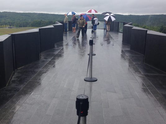 Visitors walk around the Flight 93 National Memorial.