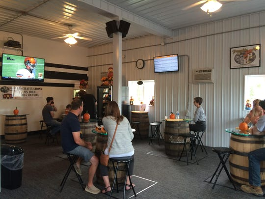 Inside Horseheads Brewing are televisions tuned to