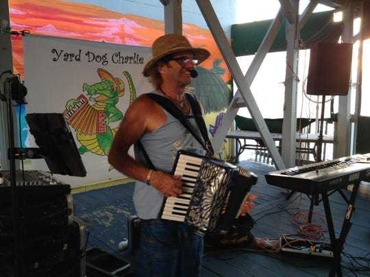 """""""Yard Dog"""" Charlie Kuchler's accordion happy hour act includes comedy and humorous songs."""