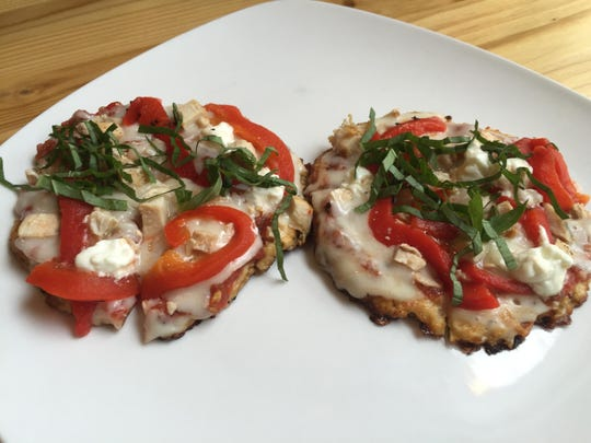 "Chicken, roasted red pepper and goat cheese pizza is built with a ""crust"" of cauliflower bread."