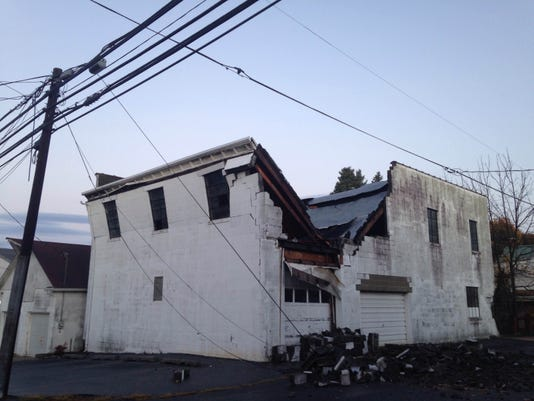 Daylight reveals damage to a building at Manheim and Cumberland streets that collapsed during Wednesday night's torrential rain.