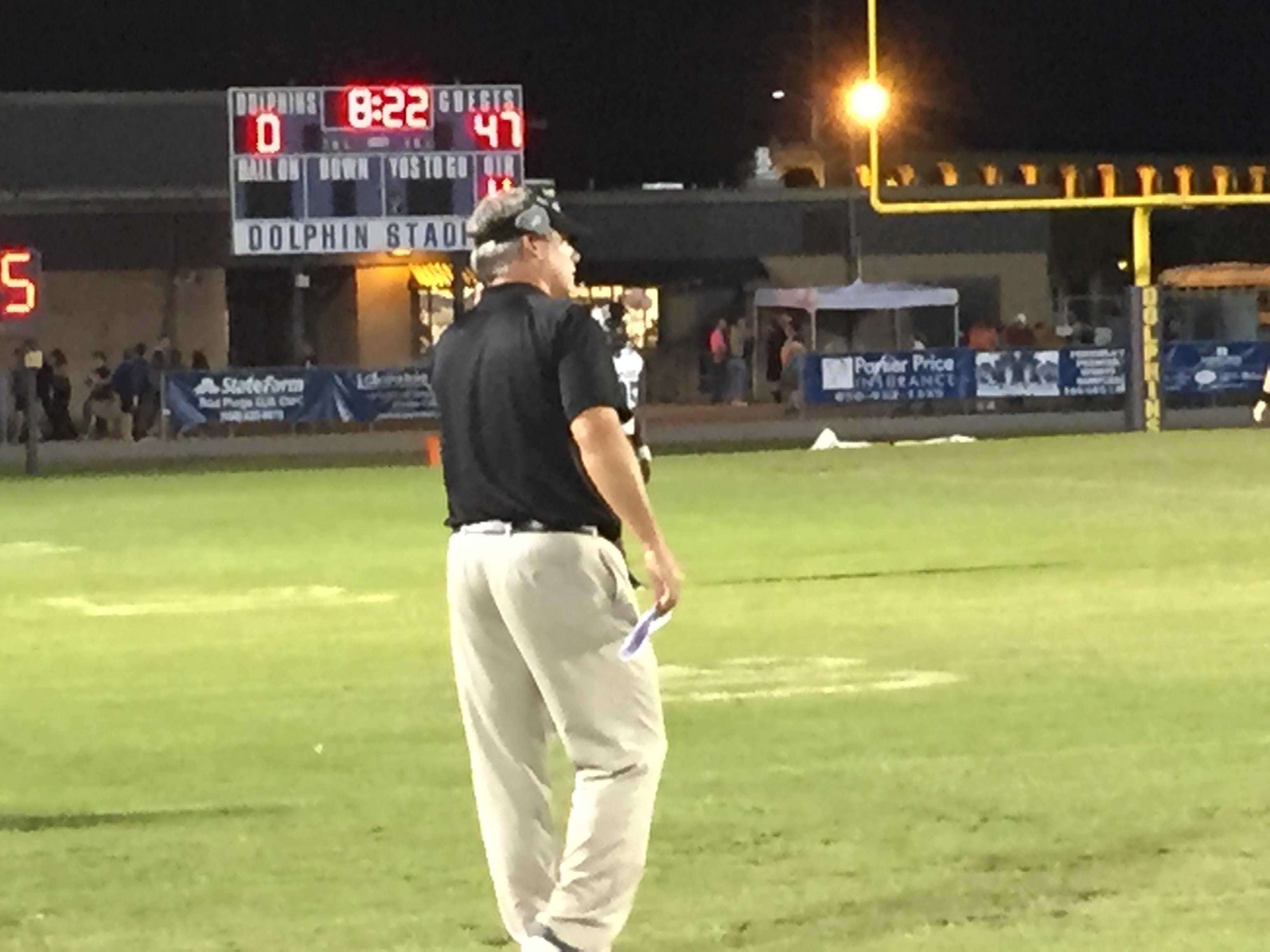 Navarre coach Jay Walls instructs his team during the Raiders' 47-7 win over Gulf Breeze.