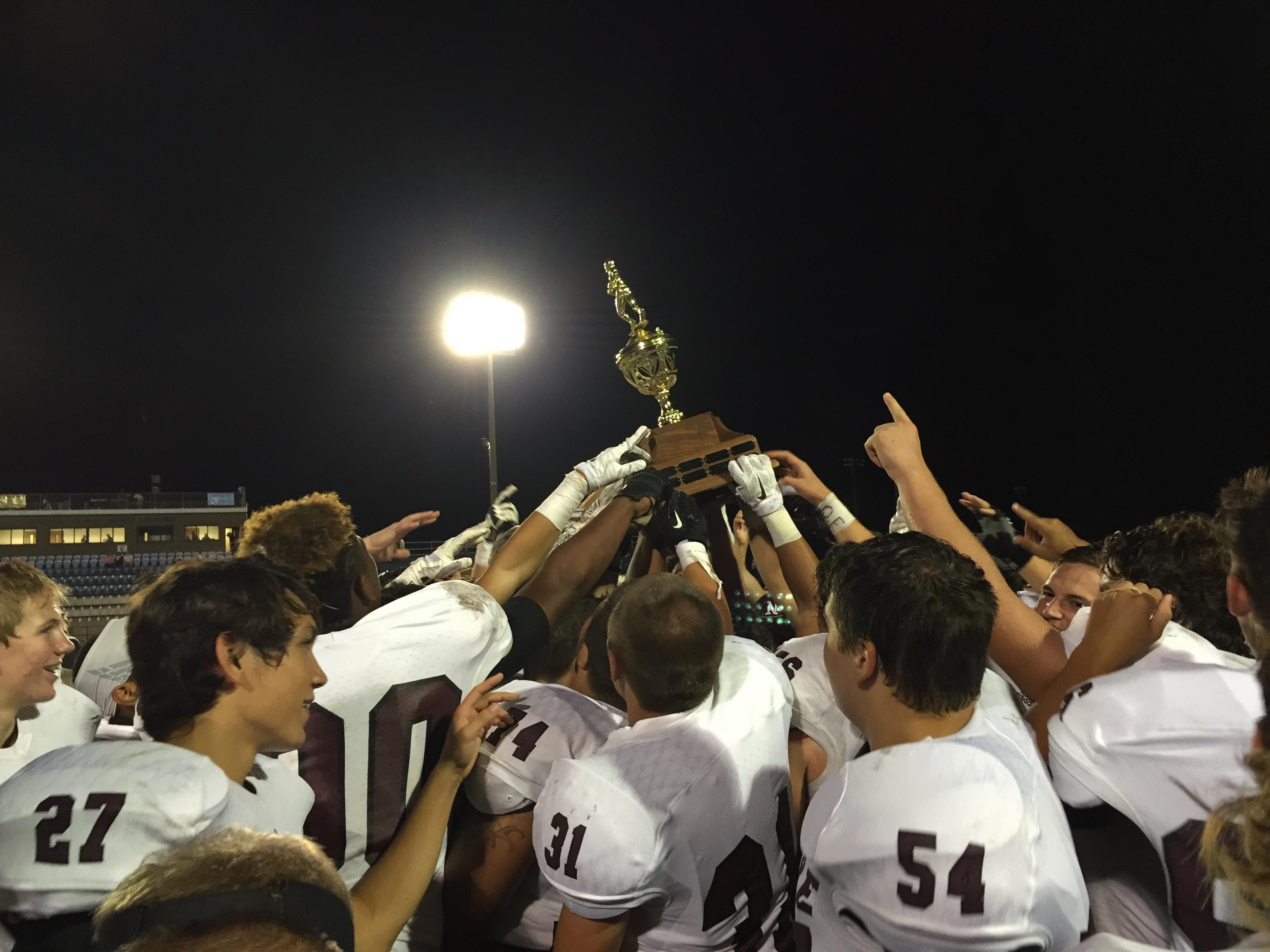 Navarre players celebrate after their 47-7 win over Gulf Breeze on Friday.